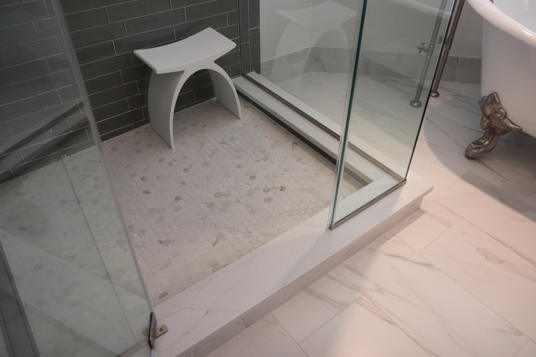 Frameless shower door, quartz shower curb