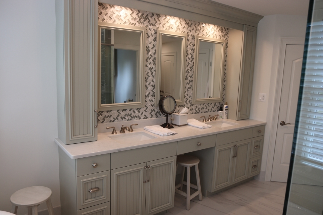 Custom vanity, glass mosaic back splash with custom mirror frames