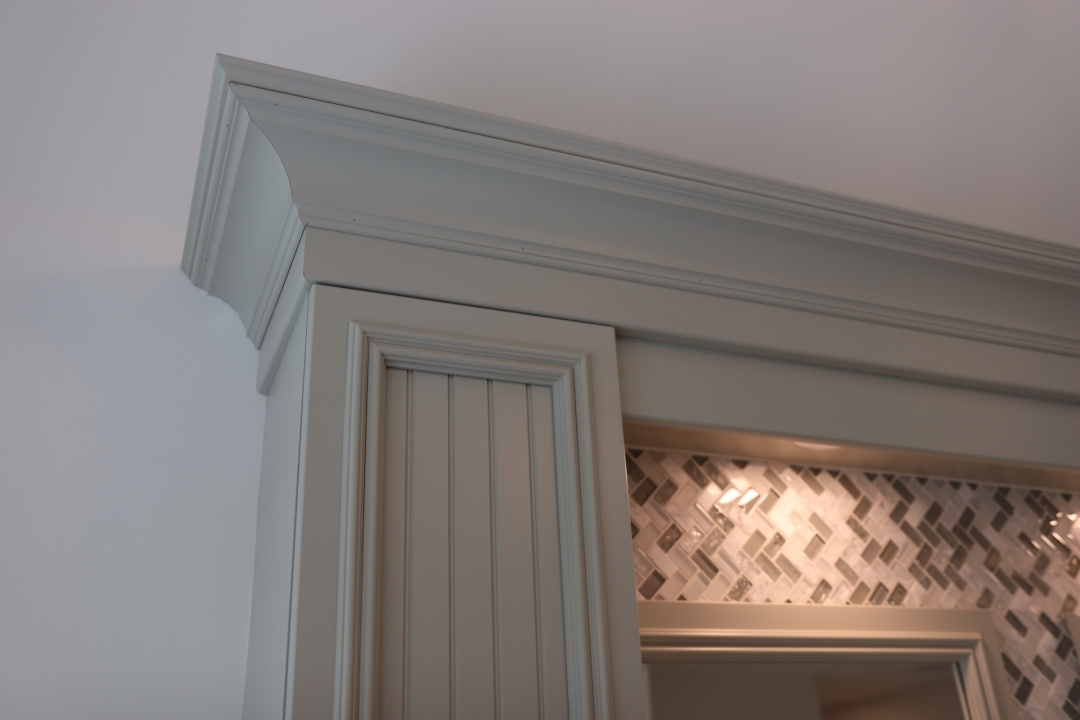 Custom color, beadboard door, crown molding
